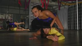 Two gymnasts doing a trick twine.  stock video