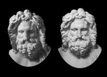 Two Gypsum Copy Of Antique Statue Zeus Head Isolated On Black Background. Plaster Sculpture Man Face With Beard. Stock Image