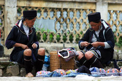Two H'mong women selling traditional hats Stock Photos