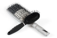 Two hairbrush on a light background Stock Photography