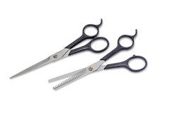 Two hairdressers scissors on a light background Royalty Free Stock Photos