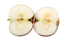 Two half. There are two half of a red apple on the white background Royalty Free Stock Photo