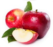 Two and half apple with green leafs royalty free stock photography