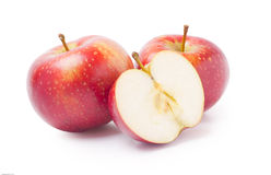 Two and half apples. Three juicy, red apples isolated on white background royalty free stock image