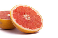 Two Half cut grapefruit isolated on white background. Half cut grapefruit isolated on white background stock photo