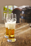 Two half drunk glasses of beer Stock Images