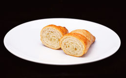 Two half of fresh baked croissant Royalty Free Stock Image