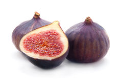 Two and a half fresh figs Royalty Free Stock Photos