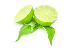 Two half of fresh lime with leaves Isolated on white background Royalty Free Stock Images