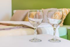 Two wine glasses in bedroom Royalty Free Stock Photo