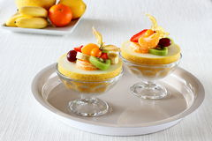 Two half Galia melon filled with summer fruits Stock Photography