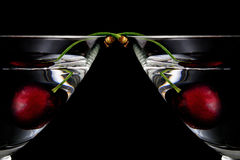 Two half glass of drink with cherry closeup isolated on a white Royalty Free Stock Image