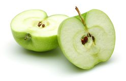 Two half Granny smith apple isolated. On white background royalty free stock photos