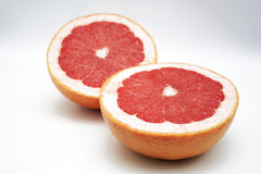 Two half of grape fruit - to be used for background Stock Photos