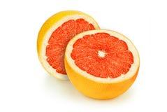 Two half grapefruit. Ripe grapefruit cut into two halves  on white background Royalty Free Stock Photo