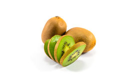 Two and A Half Kiwi fruit Half Kiwi Fruit. Whole Kiwi fruit and Kiwi fruit slices Royalty Free Stock Image