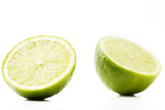 Two half limes. On white background royalty free stock photo