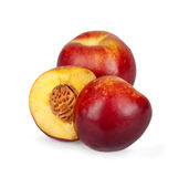two half nectarine on the background of a fruit Stock Photos