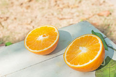 Two half of oranges on the table Stock Photography