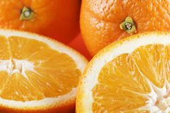 Two half oranges, two whole or Stock Photography