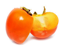 Two half persimmon Royalty Free Stock Photos