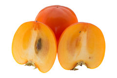 Two half of the persimmon Stock Images