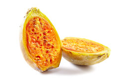 Two half pieces of cactus fruit on white. Closeup of a ripe cactus fruit (prickly pear) cut in half, isolated on white background stock photo