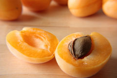 Two half of ripe apricot lay on a table Royalty Free Stock Image