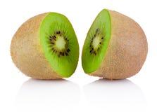 Two half of ripe juicy kiwi fruit isolated on white background. Two half of ripe juicy kiwi fruit isolated on a white background royalty free stock images