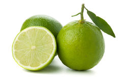 Two and half ripe limes Stock Photos
