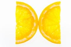 Two half slices of orange Royalty Free Stock Photos