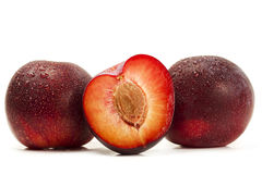 Two and a half wet plums Stock Photo