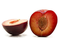 Two half wet plums Stock Photography