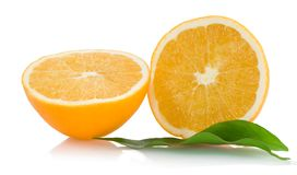 Two halfs of cropped orange withleaves Stock Photos