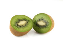 Two halfs of kiwi (white background). Fresh diet fruit. Healthy fruit with vitamins Royalty Free Stock Photography