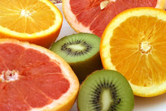 Two halfs of orange pomelo and kiwi. Halfs orange pomelo and kiwi on dish Royalty Free Stock Photography