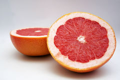 Two halfs red grape fruit Stock Photos