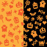 Two Halloween festive seamless retro pixel patterns in vector. With famous Halloween icons Royalty Free Stock Photo