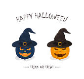 Two Halloween pumpkins in black witch hats. Halloween theme, two pumpkins in black witch hats with golden buckle isolated on white background, inscription Happy Stock Image