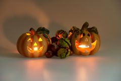 Two Halloween pumpkins with burning candles. Two Halloween pumpkins head jack lantern with burning candles Royalty Free Stock Photo