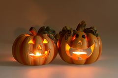 Two Halloween pumpkins with burning candles. Two Halloween pumpkins head jack lantern with burning candles Stock Photos