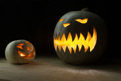 Two halloween pumpkins funny and spooky Royalty Free Stock Image