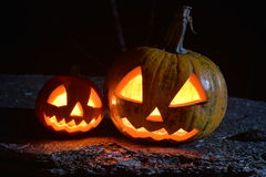 Two halloween pumpkins on hardwood plank. Under moonlight Stock Images