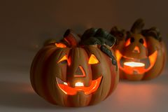 Two Halloween pumpkins with burning candles. Two Halloween pumpkins head jack lantern with burning candles Royalty Free Stock Photos
