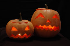 Two halloween pumpkins - Jack O Lanterns. In the night Stock Image
