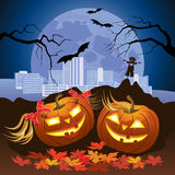 Two Halloween pumpkins in the night. Two lighted pumpkin Halloween night moon background Stock Photography
