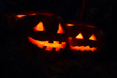 Two halloween pumpkins. Two halloween pumpins glowing in the dark Stock Photo
