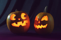 Two Halloween pumpkins. Scaring each other Stock Photos