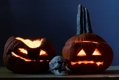 Two halloween pumpkins and scull. Glowing in the dark Royalty Free Stock Photo