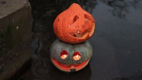 Two halloween pumpkins in the water. Two halloween pumpkins in the shallow water stock video footage